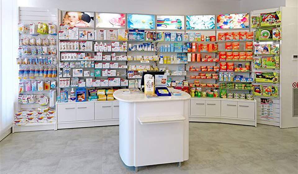ARREDO FARMACIA Banco espositore centro sala - Riganelli Arredamenti