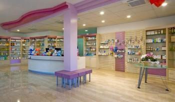 FARMACIA Arredo farmacia banco vendita, espositori e pannelli dogati attrezzabili - Riganelli Arredamenti