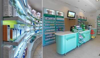 FARMACIA Banco vendita e pareti attrezzabili esposizione prodotti - Riganelli Arredamenti