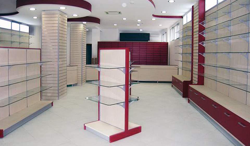 FARMACIA Espositore colonna centro sala con ripiani in vetro - Riganelli Arredamenti