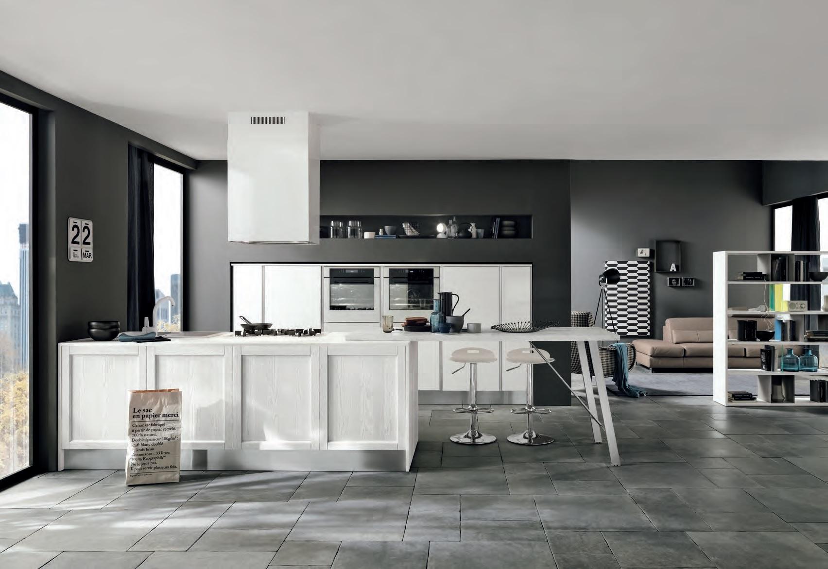 Soggiorno cucina open space contrasti bianco e nero