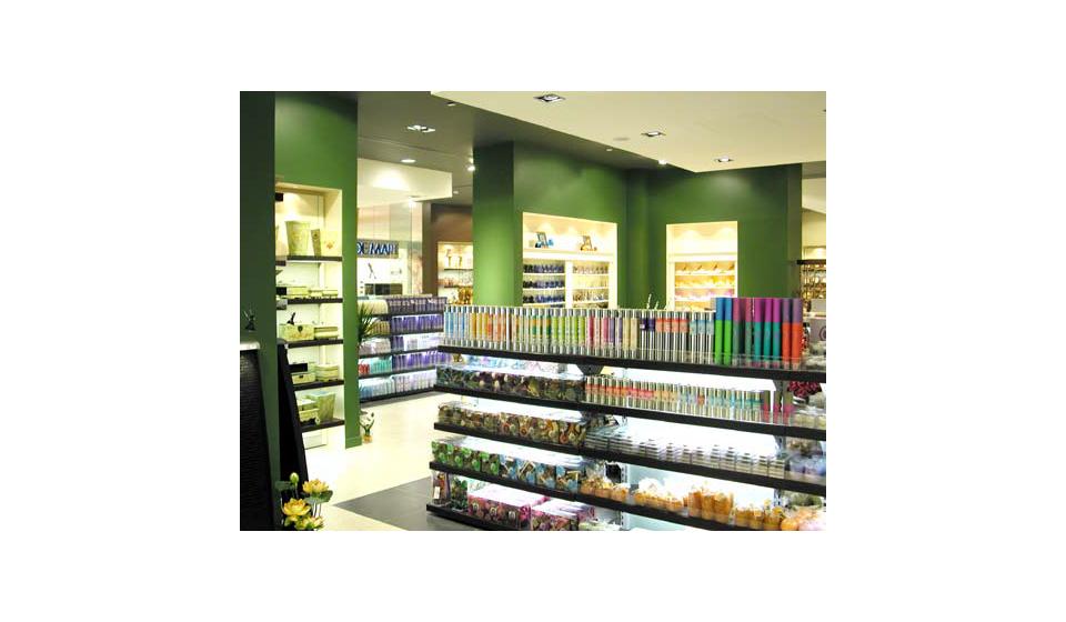 Espositore centro stanza per negozio prodotti cosmetici
