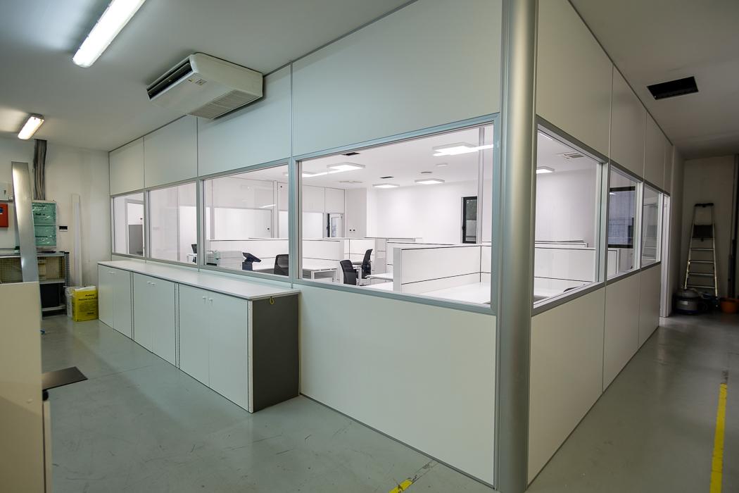 realizzazione uffici con pareti divisorie in capannone destinato alla produzione - riganelli