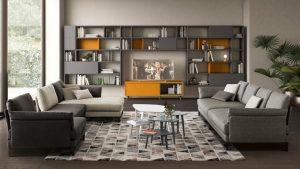 Arredare con il tappeto il soggiorno con divani e libreria - riganelli